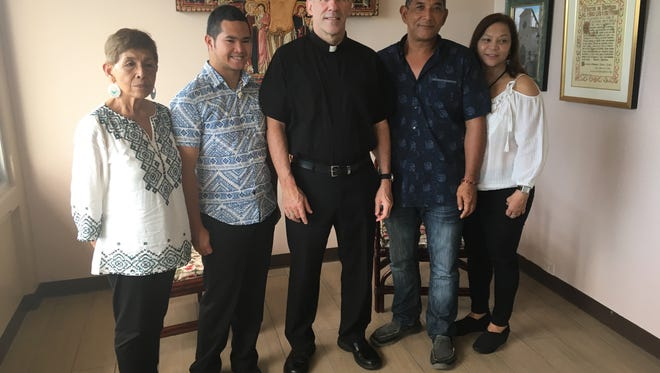 "Archbishop Michael Jude Byrnes, center, meets with the family of the now deceased former altar boy Joseph ""Sonny"" Quinata, who was allegedly sexually abused or raped by Archbishop Anthony S. Apuron in 1977. The family led by Doris Concepcion, left, and John Michael ""Champ"" Quinata, second from right, discussed with Byrnes how the sexual abuse affected their family. Also in photo are Sonny's son, Christopher Valencia, second from left, and Champ Quinata's girlfriend, Victoria Blas-Toves, right."