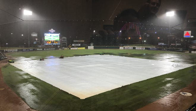 The tarp is on Whataburger Field during a rain delay on Tuesday.