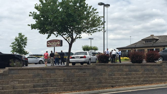 Jackson police investigate a report of shots fired at Cheddars during an investigation of a shoplifting at Walmart.