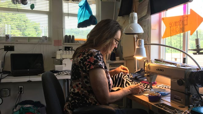 Lynn Logan, owner of Sew Fitting Alterations & Embroidery, is hard at work in her shop in Ashland City.