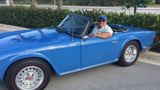 VNA of Florida and Grand Oaks CEO, Don Crow sits in his vintage Triumph