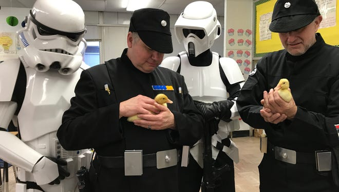 Members of the 501st Legion's Northeast Remnant hold baby ducks during the 2017 science fair at Upper Greenwood Lake Elementary School in West Milford.