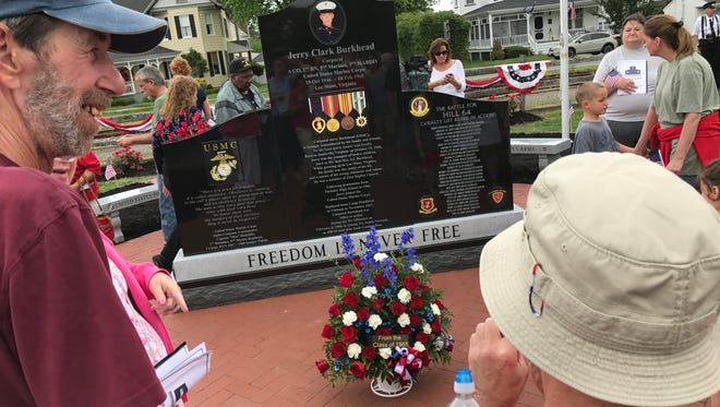 Hundreds attended the Cpl. Jerry C. Burkhead/Town of Parksley War Memorial dedication ceremony on Monday at the Parksley Town Square. The polished black monument memorializes Burkhead, who lost his life in battle during the Vietnam War, and all fallen soldiers from Accomack County.