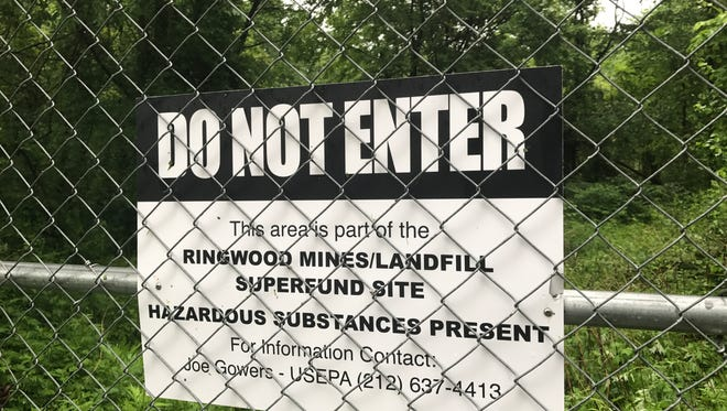 The Ringwood Superfund site sits behind chain-link fence off Peters Mine Road in Ringwood on May 25, 2017.