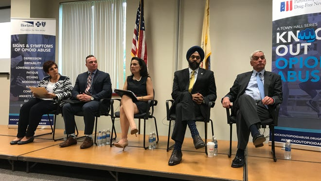 A panel of experts discussed the opioid epidemic in Bergen County in the Tech Center at Bergen Community College in Paramus on Wed., May 31, 2017, during the Knock Out Opioid Abuse town hall series. Seated (left to right) are  Division of Addiction director Sue A. Marchese-Debiak, Director of Clinical Outreach and Advocacy Director for SOBA College Recovery Joel Pomales, Director of the Center for Alcohol and Drug Resources Samantha Harries, Bergen County Prosecutor Gurbir S. Grewal, and Michael Kelly, a professor and chairman of the Department of Orthopaedic Surgery and Sports Medicine at Hackensack University Medical Center.