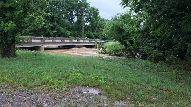 Lower Station Camp Road in Gallatin is closed in both directions due to flooding Monday, June 5, 2017