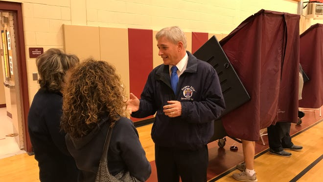 Republican gubernatorial candidate Steve Rogers greets friends  at Nutley's Spring Garden School after casting his vote on Tuesday, June 6, during the New Jersey primary election.