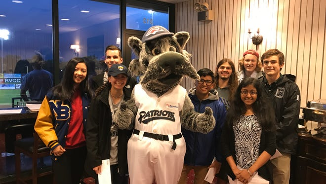 The 2017 Central Jersey Academic All-Stars pose for a photo with Somerset Patriots mascot, Sparkee.
