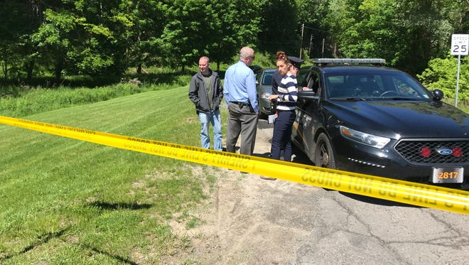 """Monroe County sheriff's deputies and investigators on scene of """"unattended death"""" on Old Browncroft Boulevard in Penfield Wednesday."""