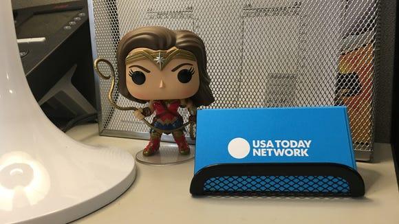 "A ""Wonder Woman"" Funko POP! figure stands on a desk."