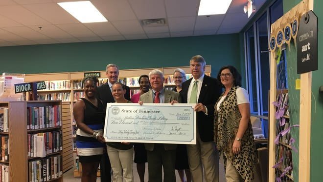 Secretary of State Tre Hargett presents a check for $9,000 to Jackson-Madison County Library Director Dinah Harris.