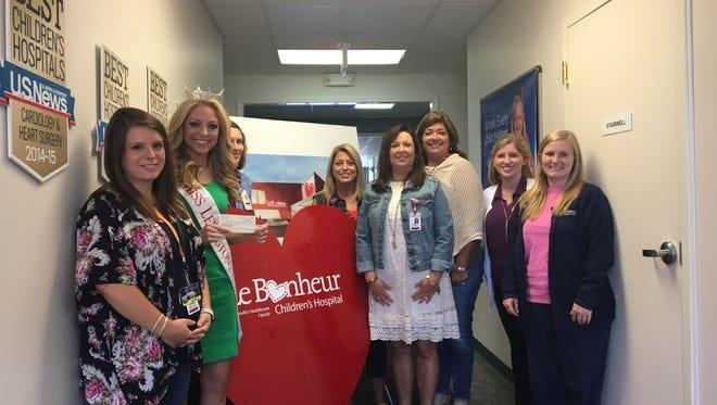 Miss Lexington Caty Davis presents a check to Le Bonheur Children's Hospital on Wednesday, June 7.