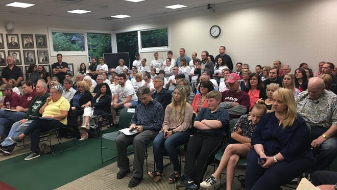 Residents for and against a proposed ordinance to ban parking near Demarest Farms filled the Hillsdale Council Chamber Thursday night.