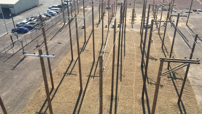 A bird's-eye view of many power lines covering the work site where APS linemen train to quickly restore power after outages.