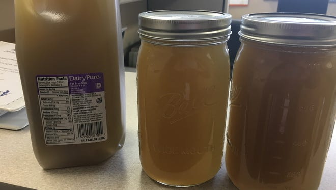 These jars contain brown water taken from a tap in Kewaunee County that researchers tied to the recent spreading of manure on a nearby field. The soil from the field and water from the home shared the same signatures for fecal contaminants.