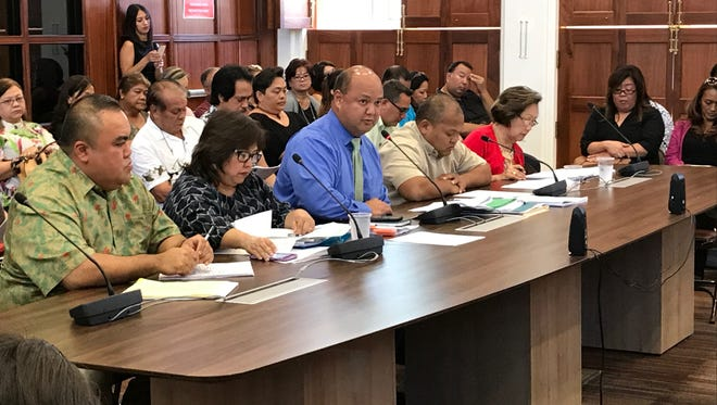In this June 9 file photo, Superintendent Jon Fernandez, center, and other Department of Education officials present the department's fiscal 2018 budget request to lawmakers.