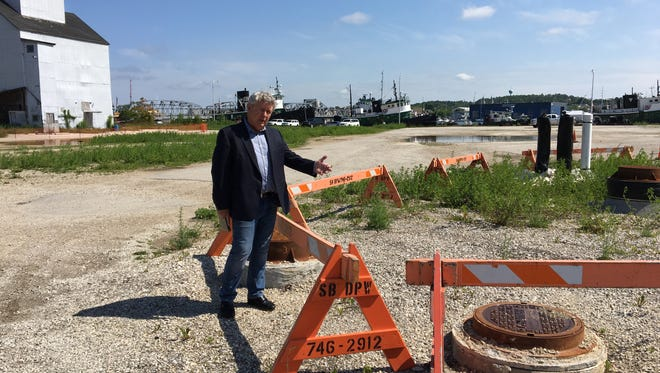 Bob Papke points to the sewer hookup installed by the city for the proposed hotel.
