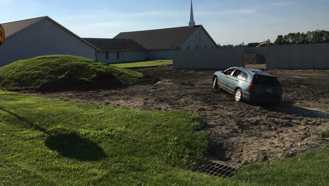 A car drove into a ditch off London West Road just north of Shelby on Sunday, June 11, 2017. The driver and passenger apparently overdosed, according to the Ohio Highway Patrol.