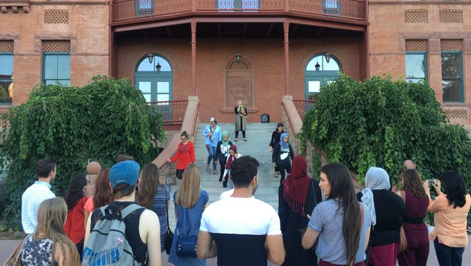 Members of the Afghan Students Association at ASU were joined by others Monday in front of Old Main to remember people killed in recent bombings in Afghanistan.