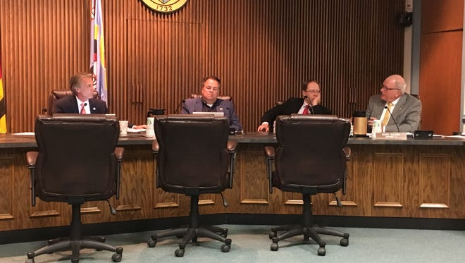 Wicomico County Councilman John Hall, right, explains why he doesn't support cuts to the county budget at a meeting on Monday, June 12. From left are Council President John Cannon and councilmen Larry Dodd and Marc Kilmer.