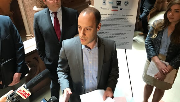 Alex Camarda of Reinvent Albany speaks at a news conference