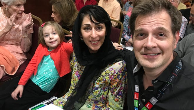 Christopher S. Welch, right, his wife, Raihana Zaka, and their daughter, Aliya, of Randolph, attend an interfaith Iftar dinner at the Islamic Center of New Jersey in Rockaway on June 13, 2017.
