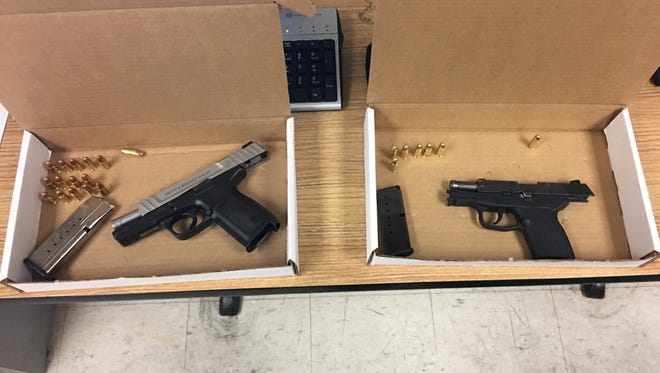 Police recovered these guns from the men.