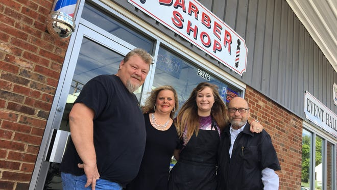 Joe and Holly Humphrey (pictured here with barbers Alex Swecker and John Barnes) now own and operate the West End Barber Shop business in Staunton. They also own the thrift store — Nearly New Thrift Shoppe — just a few doors down.