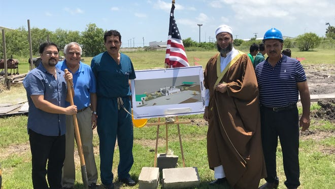 Members of the Islamic Society of South Texas break ground on their new mosque Friday, June 16, 2017.