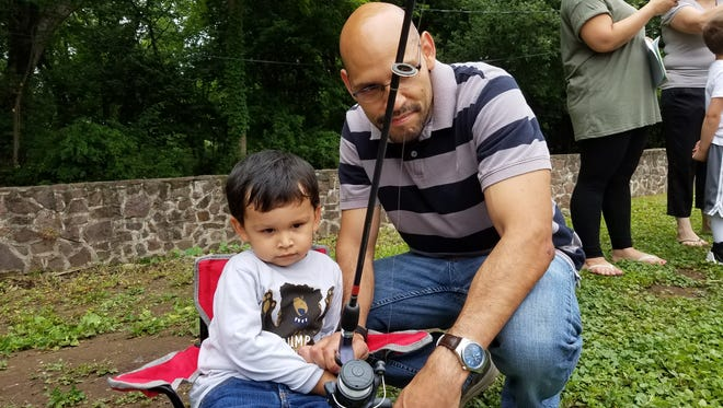 A father and son fish together Saturday, June 17, at the first Bergenfield Elks Club Fishing Derby in 20 years.