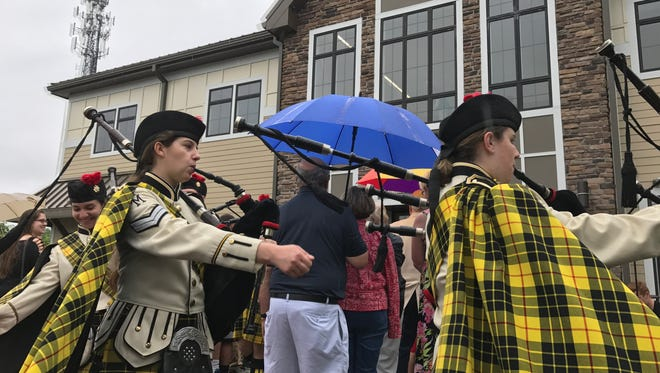 The high school pipe band played as West Milford's new library and community center opened its doors to the public for the first time on June 17, 2017.