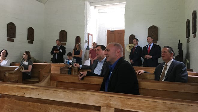 Congressman Clay Higgins joins Lt. Gov. Billy Nungesser and Lafayette Mayor-President Joel Robideaux for a tour of Acadian Village, including its New Hope Chapel, before a tourism roundtable discussion Monday, June 19.