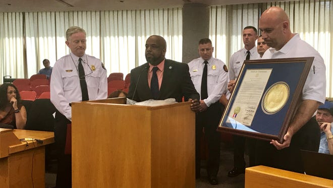 State Rep. Rick Staples, D-Knoxville, honored the fire fighters who saved the life of a one-month-old-boy who was thrown out of a third floor window of a burning building in April.