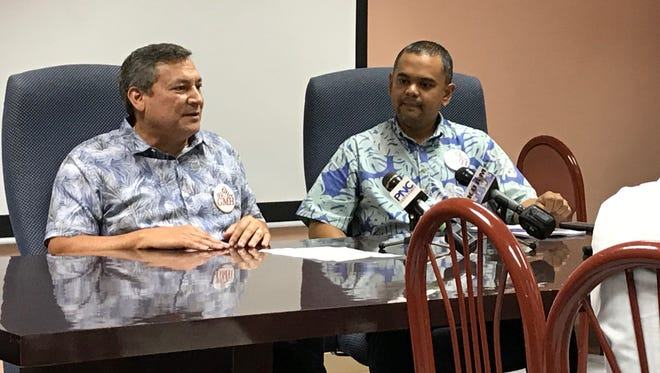 Gov. Eddie Calvo and Sen. Dennis Rodriguez, Jr., hold a joint press conference at the Guam Memorial Hospital in this file photo. Calvo signed Rodriguez's bill into law on Nov. 9, expanding health insurance coverage to some 15,000 individuals who are uninsured or under-insured.