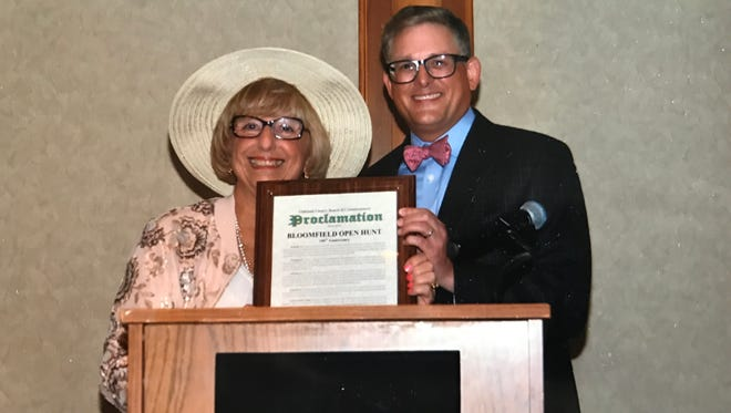 Oakland County Commissioner Shelley Goodman Taub presents Dean Groulx with a proclamation celebrating Bloomfield Open Hunt's 100th anniversary.