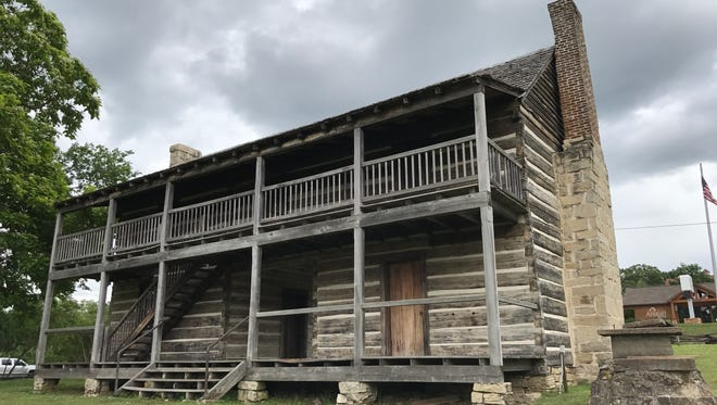Recent work at the Jacob Wolf House Historic Site included maintenance work on the Jacob Wolf House (shown above) and an exterior renovation on the John Wolf Cabin.