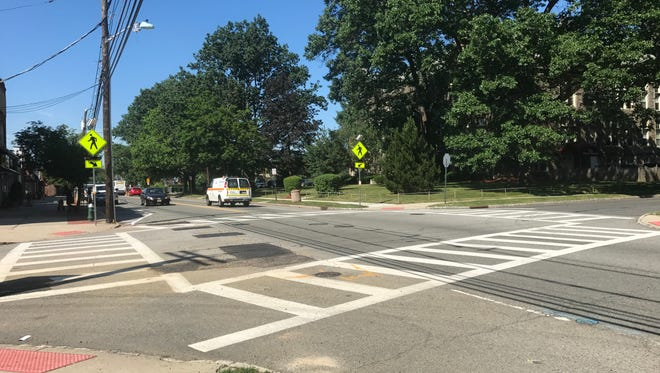 Crosswalks and pedestrian crossing signs are seen at an intersection where four pedestrian-related collisions have occurred since 2014.