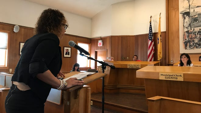 Gladys Delgado, owner of the Huddle Sports Bar & Grill addresses the Nutley Board of Commissioners on June 26, 2017.