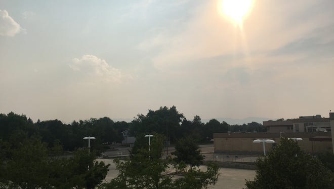 The view from the Coloradoan office toward the west is hazy on June 27.