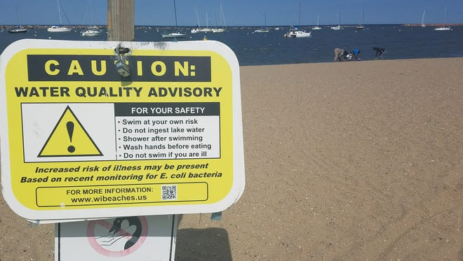 A caution sign was up at South Shore Beach while Shontay Harris' family was playing near the water.