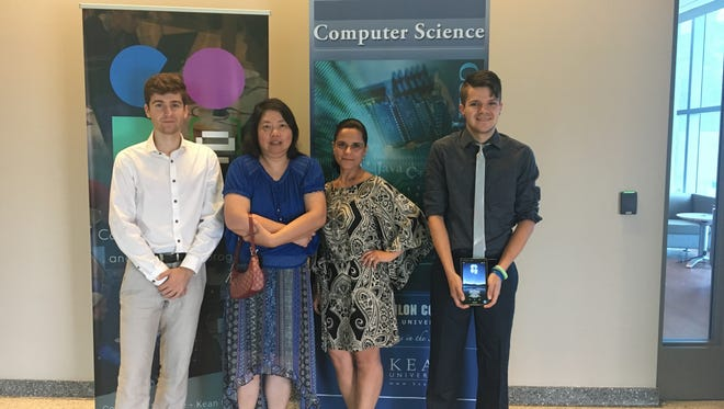 Left to right: Andrey Suvorov, Jenny Li, Claudia Fortes and Peter Krivoshik (left to right) recently presented their research at the NJ Tech Council's What's Next in Medical Devices event.