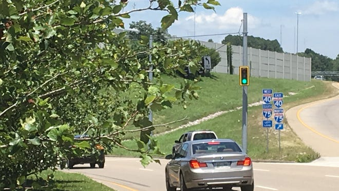 City workers in June installed traffic signals on vertical poles  already suspending signals over the east and westbound lanes of Papermill Drive. The signals were added because maturing trees in the the curving medians obstruct a driver's view of the signals.