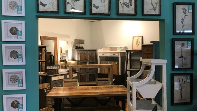 The new Nadeau store offers solid wood furniture imports and some smaller items like framed art.