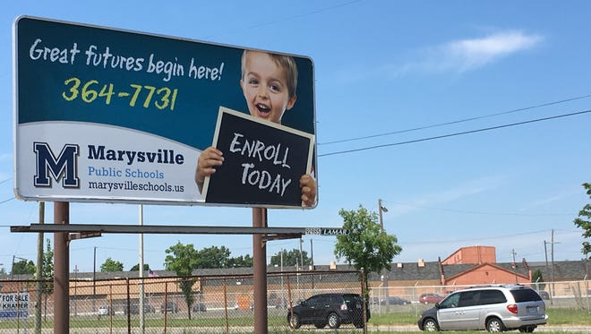 One of at least three billboards advertising Marysville Public Schools stands on the corner of Electric and Buena Vista in Port Huron.