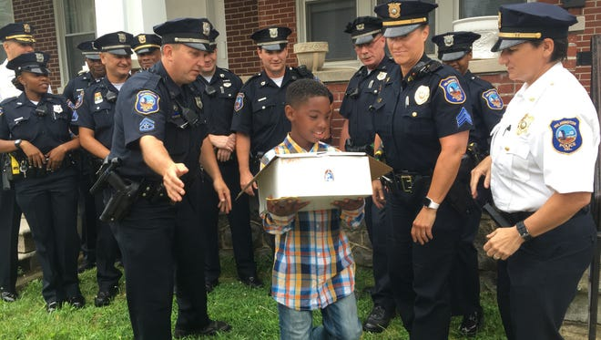 Wilmington police officers from the city's D-Platoon surprised 11-year-old Jarrell Turner at his home Thursday for the boy's birthday.