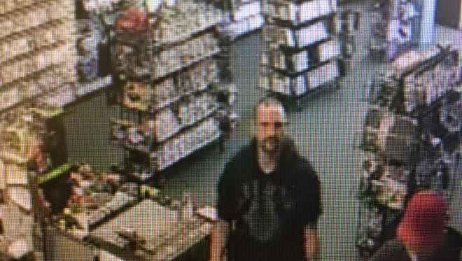The Ottawa County Sheriff's Office is asking for help from the public to identify this man caught on security camera footage allegedly stealing from C & C Games in Portage Township.
