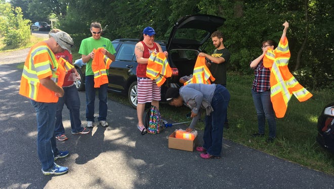 Augusta County prosecutor Tim Martin (left) gears up Saturday on Roman Road with members of the Young Democrats of Staunton Augusta Waynesboro and the Young Republicans of the Shenandoah Valley.