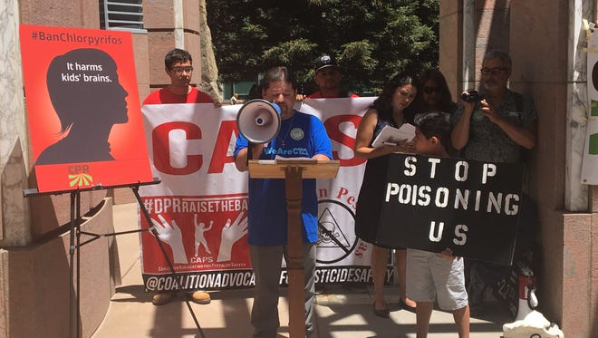 Sherwood Elementary School teacher Oscar Ramos voices his opposition to the use of chlorpyrifos