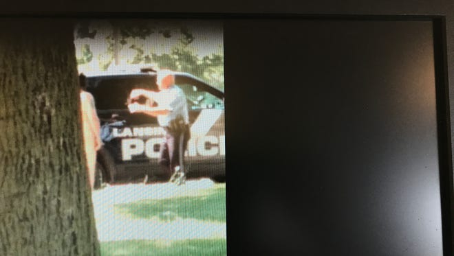 A photo of a computer screen displays a Facebook video of a naked man who had been crawling along Pennsylvania Avenue in Lansing on July 17, 2017. The video has gone viral.