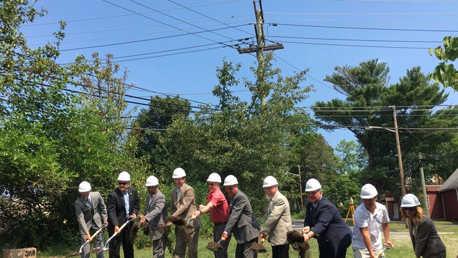 Officials from the Board of Chosen Freeholders, Edison, and South Plainfield participate in the ground breaking ceremony.